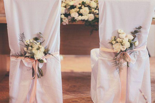 white flowers + pink ribbons http://weddingwonderland.it/2015/05/matrimonio-rocknroll-pastello.html