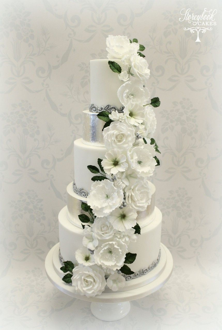 5 tier white and silver wedding cake with white floral cascade ...
