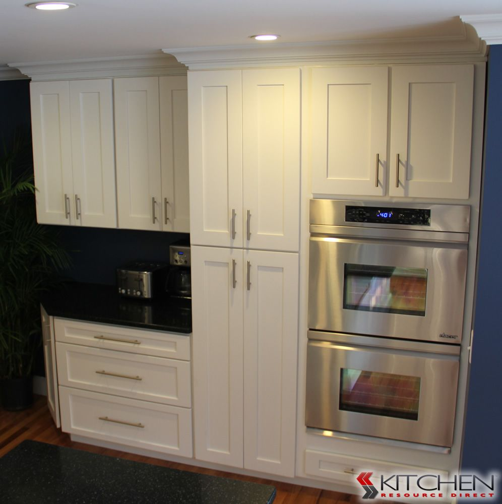 White Kitchen Feature Wall great wall of cabinets with plenty of storage; deerfield shaker ii