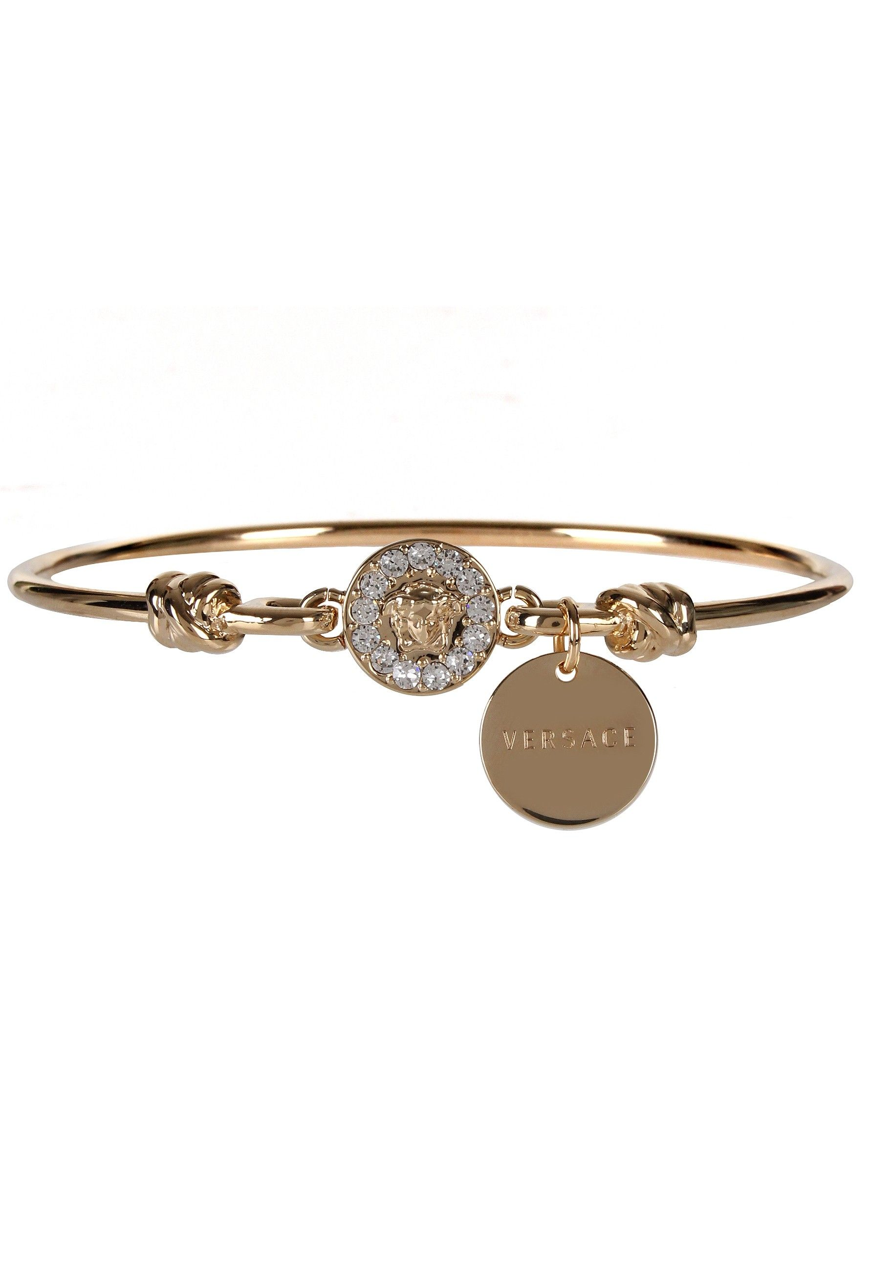 d09a86040a55 Versace Crystal Medusa Bracelet in gold. On a solid gold bangle