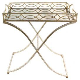 """Tray-style metal side table with a curving x-shaped base and openwork detailing.   Product: Side tableConstruction Material: MetalColor: Distressed cream  Features: Openwork detailingTwo small handlesX-shaped base  Dimensions: 27.5"""" H x 24.75"""" W x 14.75"""" D"""