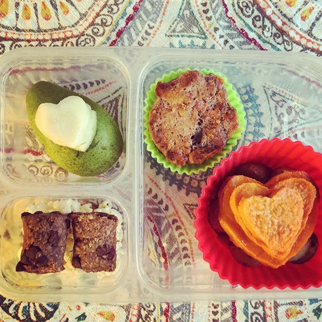 School lunch: organic pear heart, leftover mini meatloaf muffin, roasted sweet potato hearts, popcorn and MySuperSnack Chocolate Chip Granola Bites. heartheart (I always wonder what people do with the leftover shell of the heart foods, so in case anyone is wondering, we ate the outsides of the potatoes last night with dinner and the outside of the pear today with breakfast +1).