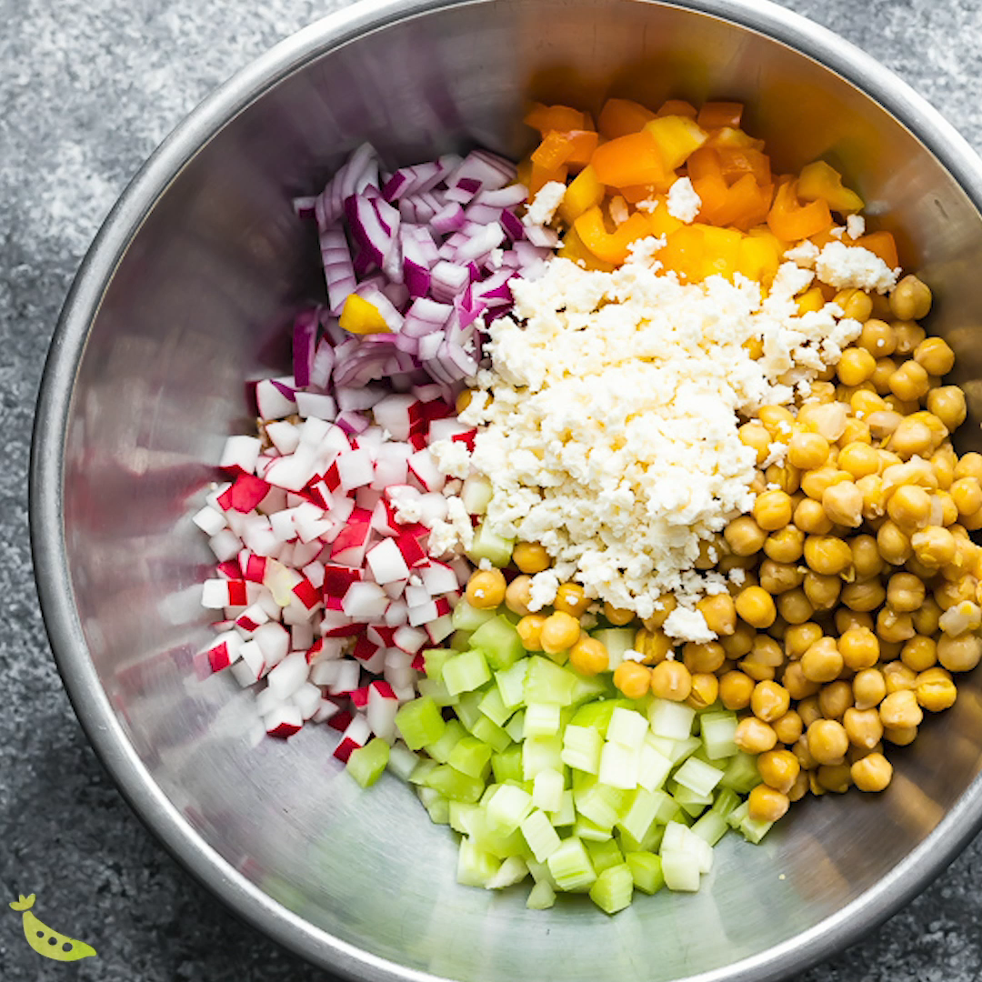 This chopped chickpea salad with bulgur wheat, crunchy veggies, feta cheese, and a delicious lemon vinaigrette is a delicious make-ahead salad that tastes even better on day 2! #mealprep #salad #vegetarian #bulgur #chickpeas #vinaigrette #sweetpeasandsaffron #makeahead #video