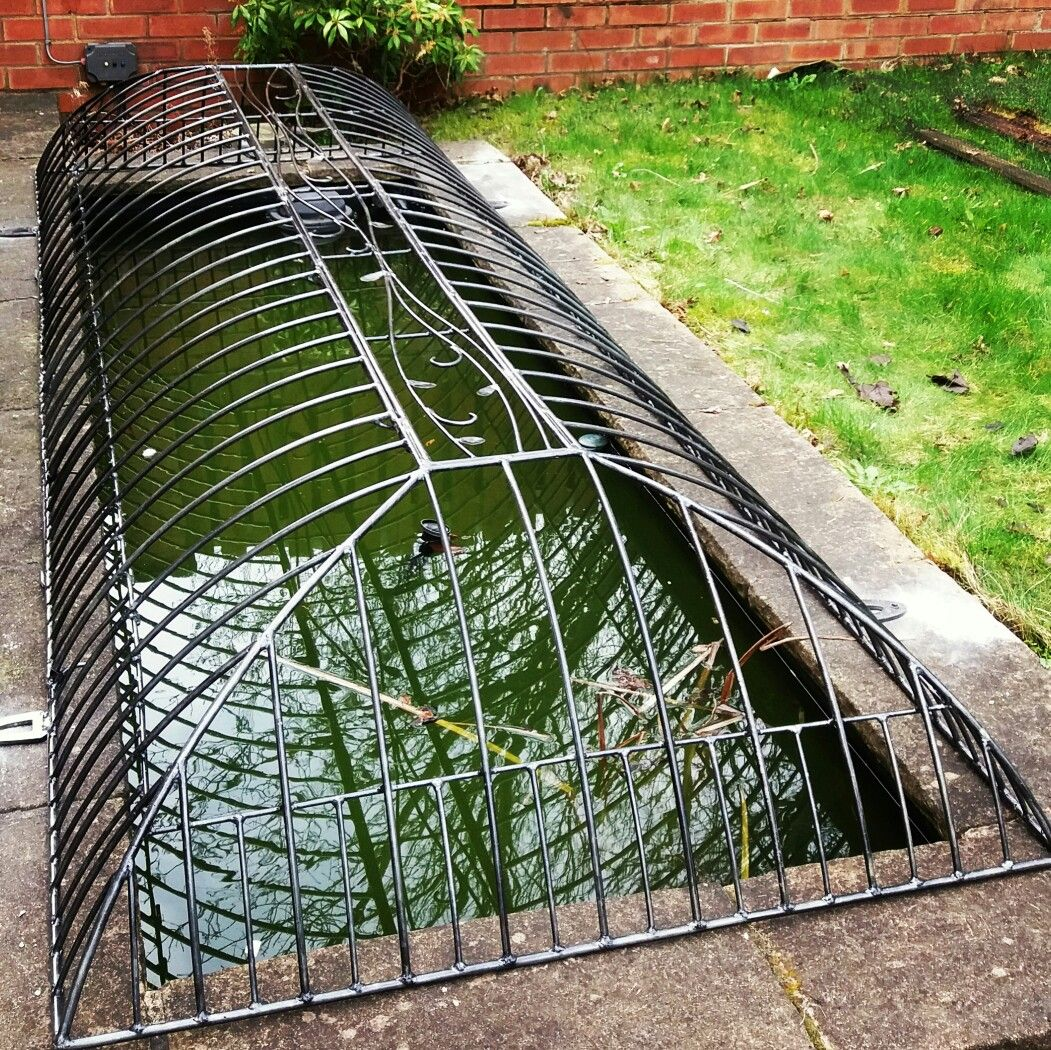 Pond Safety Cover For Adopting Couples With Added Cat