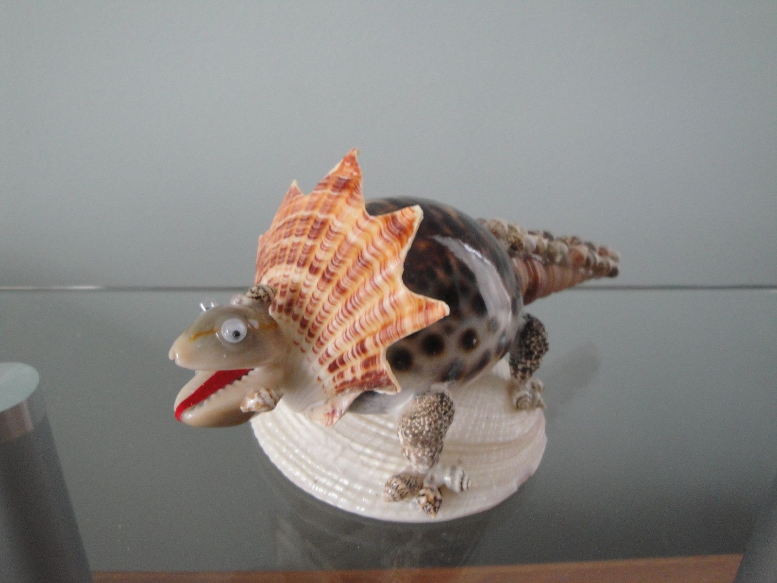 Sea shell seashell tiger dinosaur figurine philippines for What are shells made of
