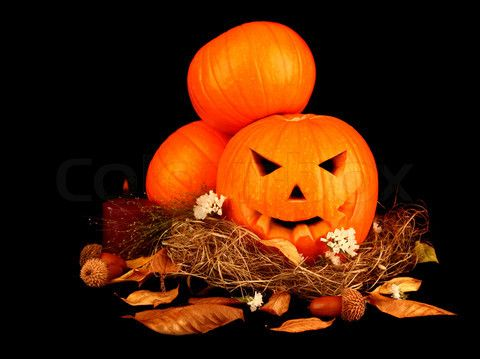 Stock image of 'Scary halloween pumpkins isolated on black background'