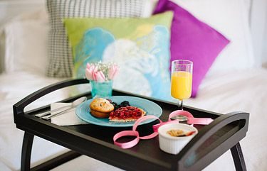 Tray with breakfast food for anniversary date idea a year of dates
