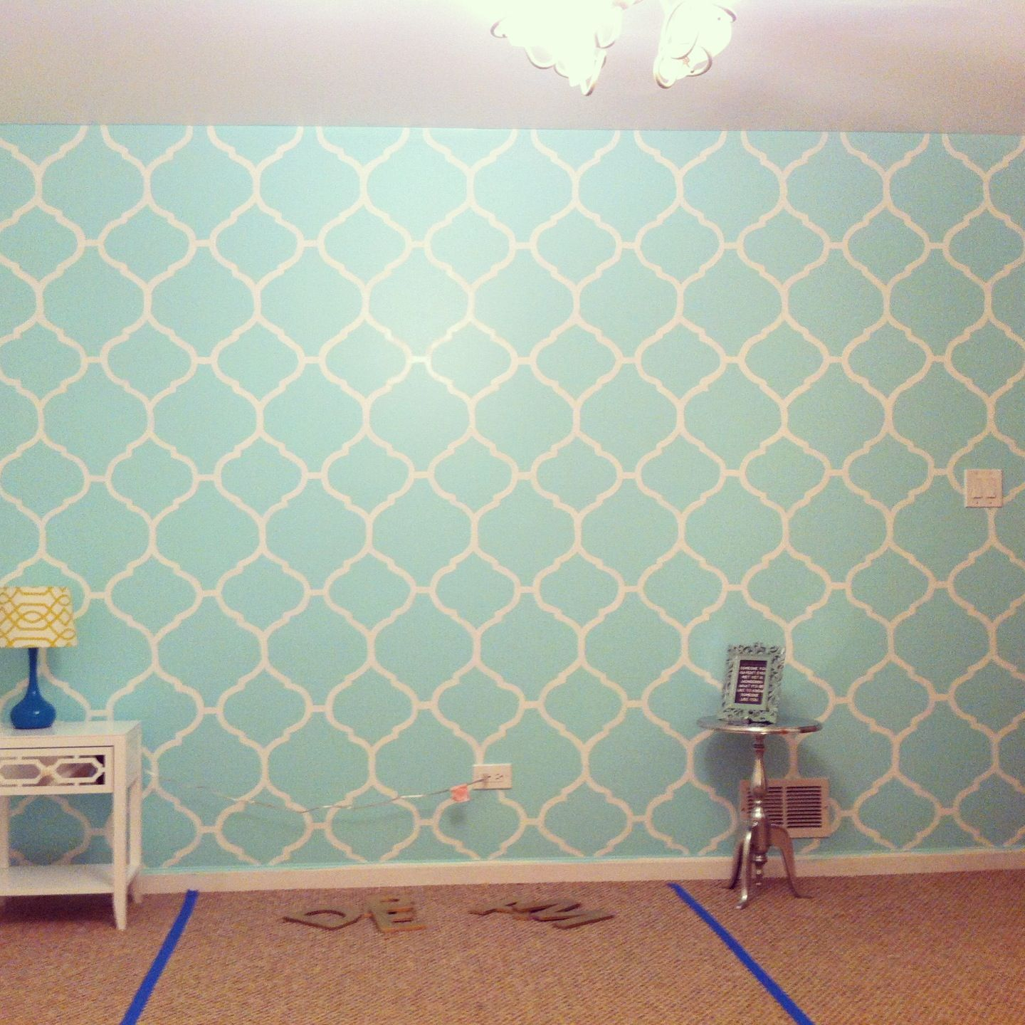 My mint green bedroom accent wall. Freehand painted