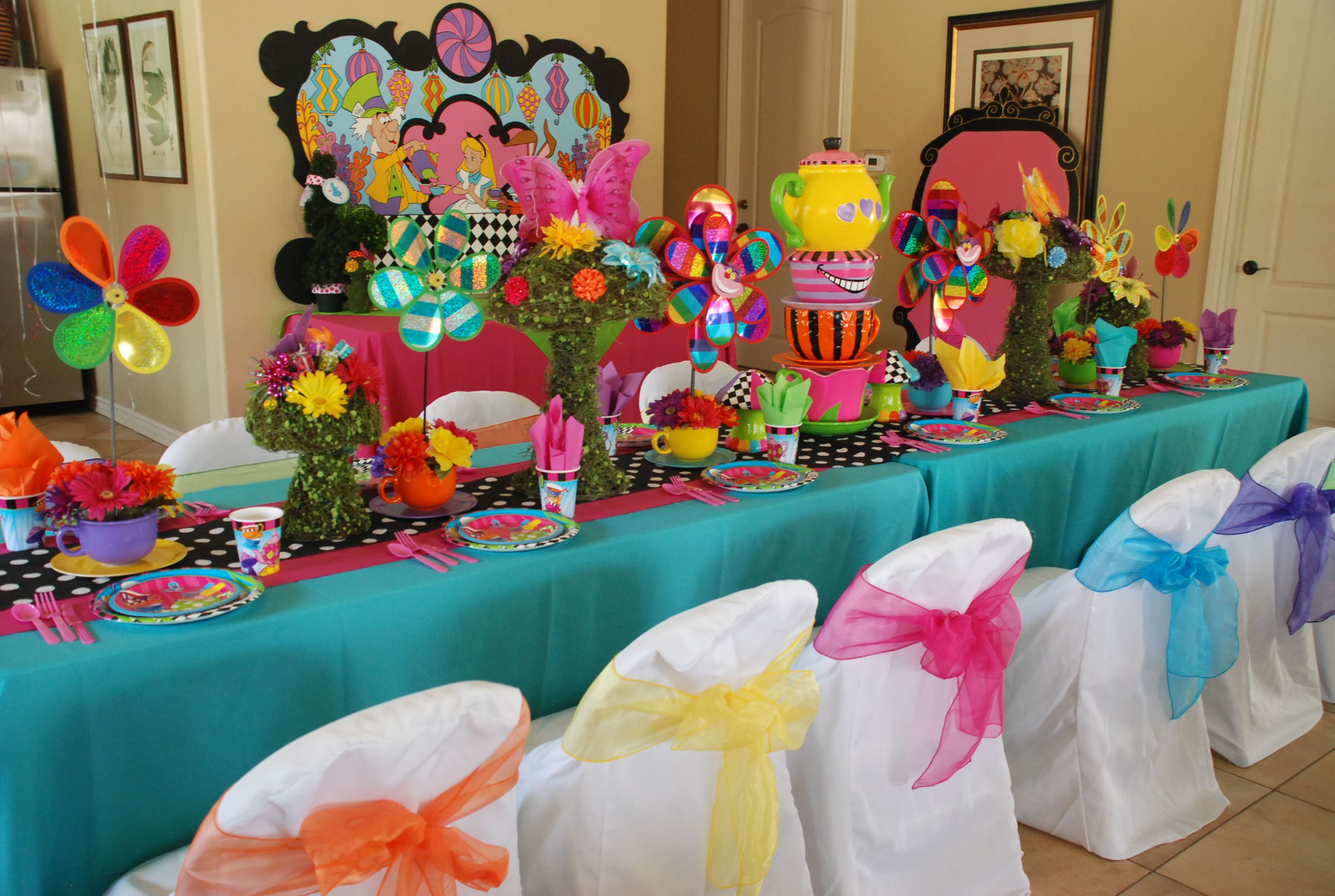 Wonderland theme Mad Hatter party table designed by: WONDERLAND PARTY PROPS. See us on Facebook for prop rental and decorating services.