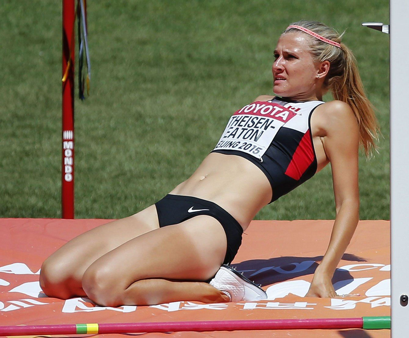 Brianne Theisen-Eaton reacts after failing to clear the 1.83m high jump bar