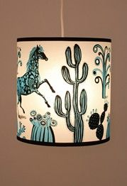 lampshade with a blue horse and cacti design