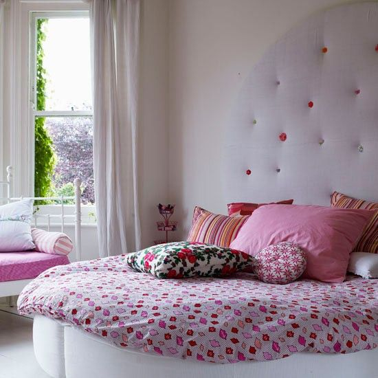 this girls room has a cute bespoke headboard to match the shape of the round bed - Girly Bedroom Design