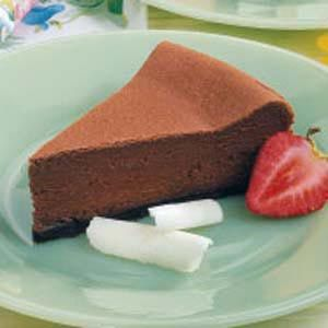 """Chocolate Cheesecake Recipe -Everyone's a chocolate lover when it comes to this special dessert. """"It melts in your mouth!"""" and """"Very smooth and fudgy!"""" are typical comments I've heard after guests take a bite. For a fun taste twist, spoon cherry or strawberry topping over each slice."""