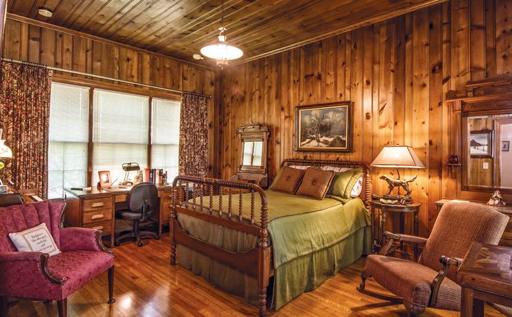 rustic log cabin bedroom pine wood walls neutral interior green