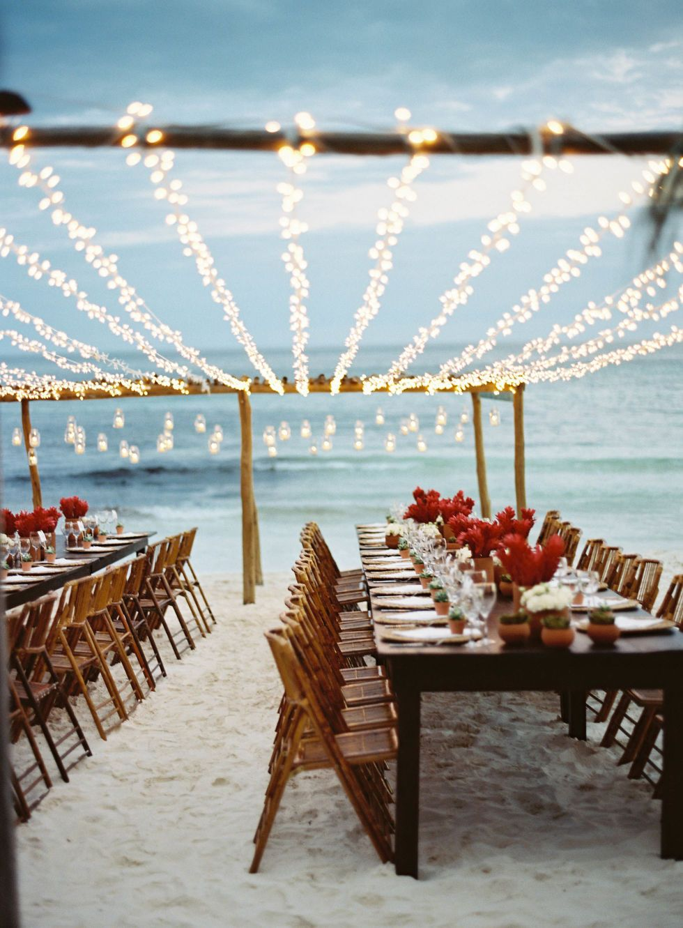 Wedding colors for a beach wedding  The Most Idyllic Beach Wedding  Tiki lights White christmas lights