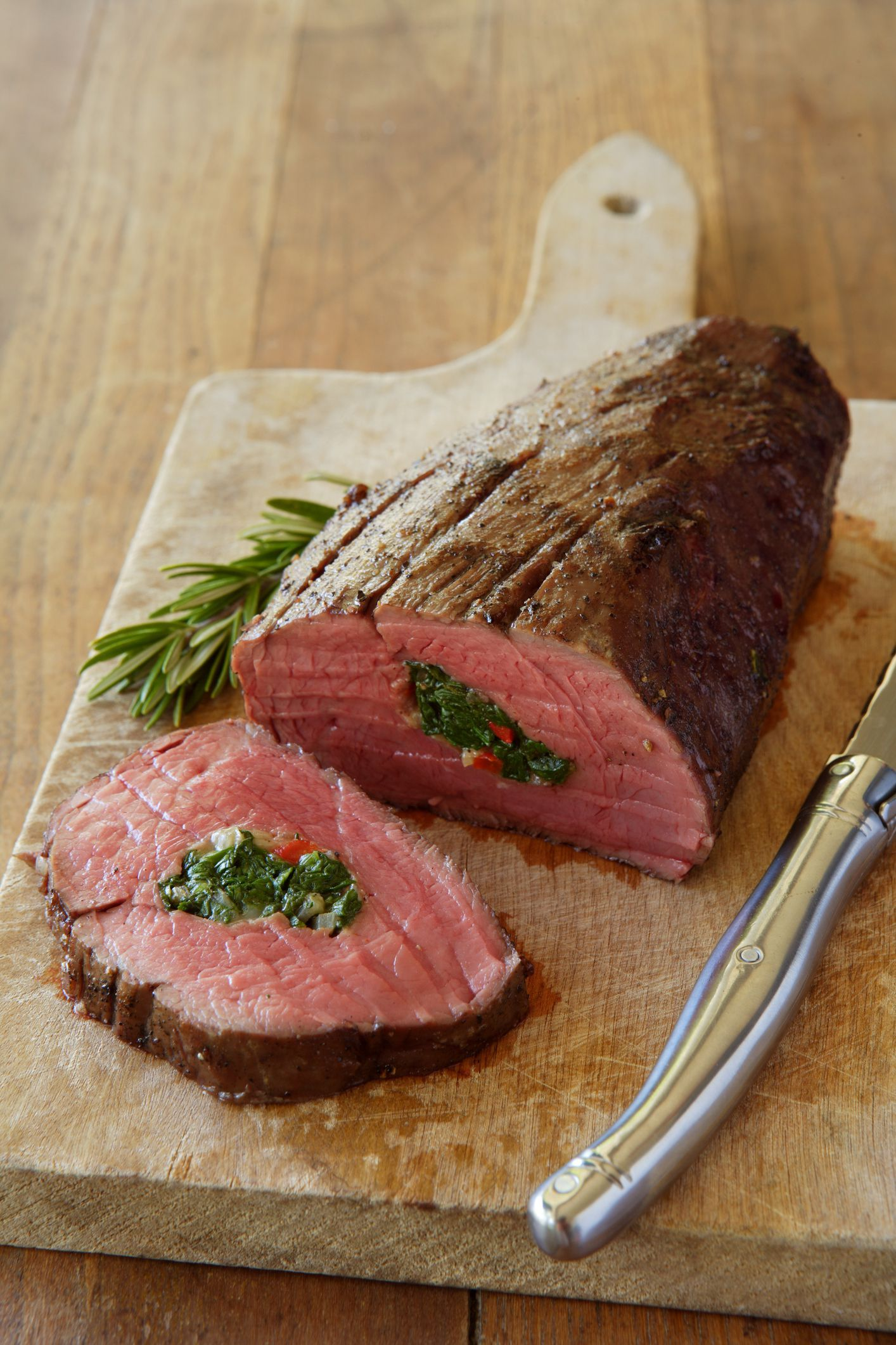 Beef Tenderloin Stuffed With Peppers Spinach Goat Cheese In Wine Recipe Beef Tenderloin Beef Tenderloin Recipes Stuffed Peppers