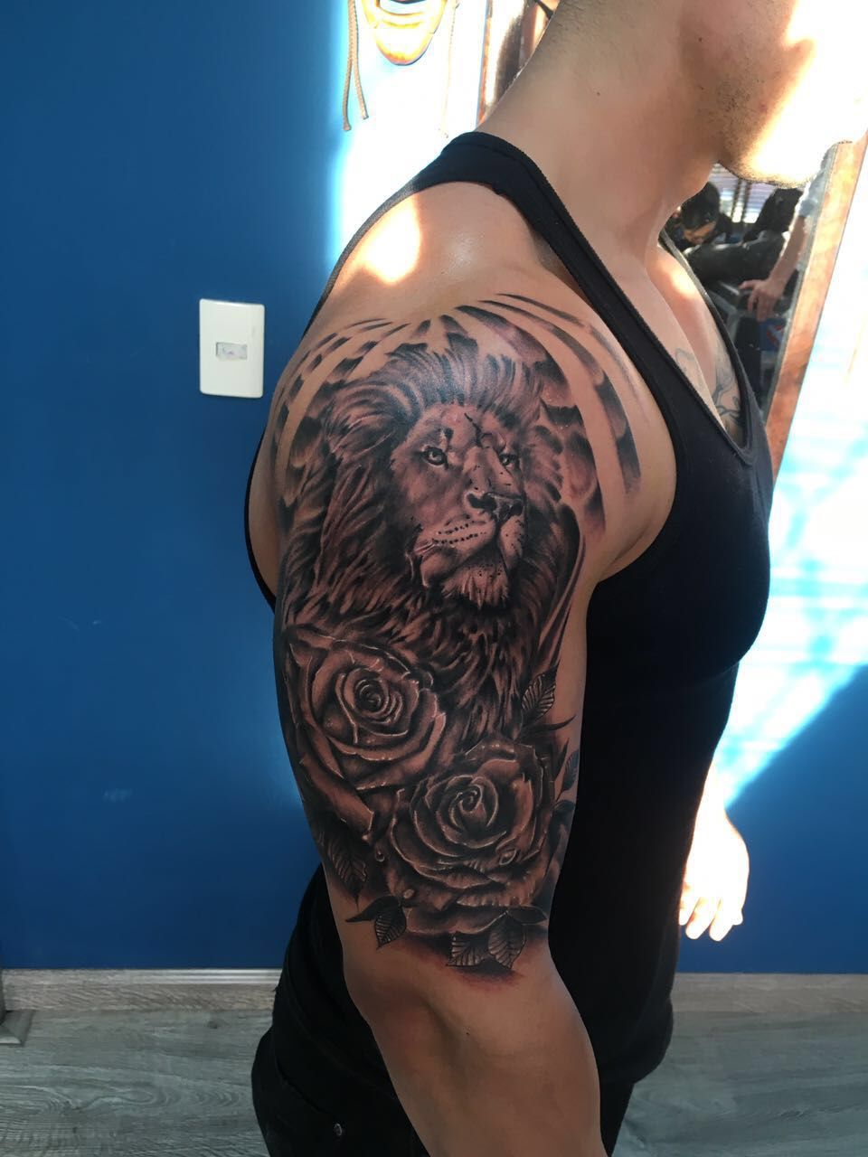bd08dfb32 Lion, Roses and lighting half sleeve tattoo | Tats | Lion tattoo ...