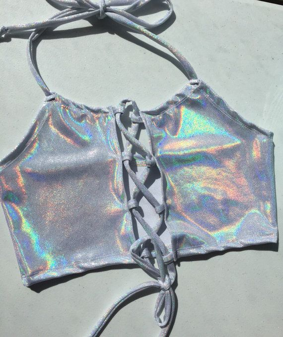 This listing is for a handmade stretch lycra spandex lace up front halter top. This halter comes with a back to it and ties at the neck. Available in