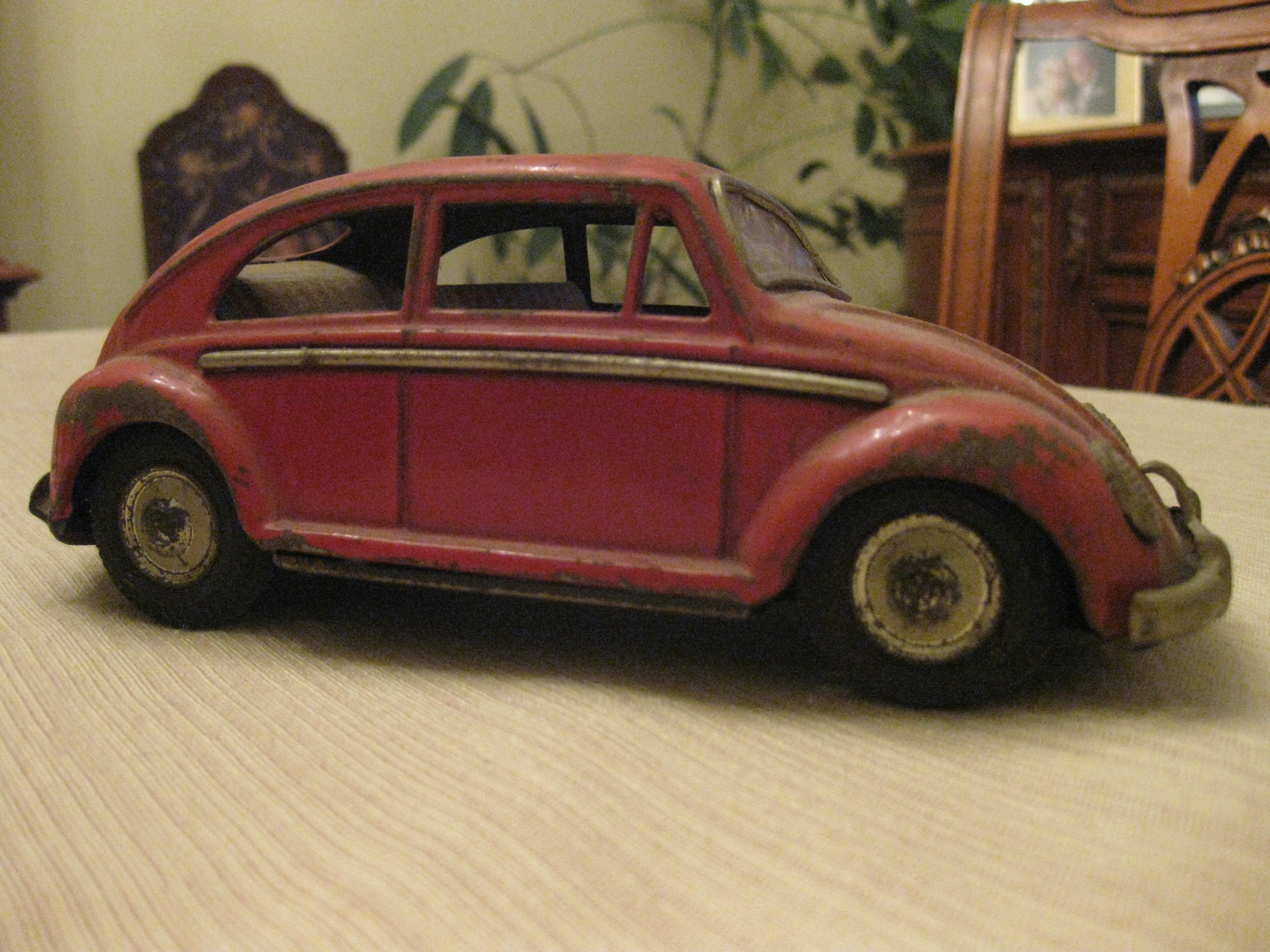An old 50's beetle toy car made in post war japan