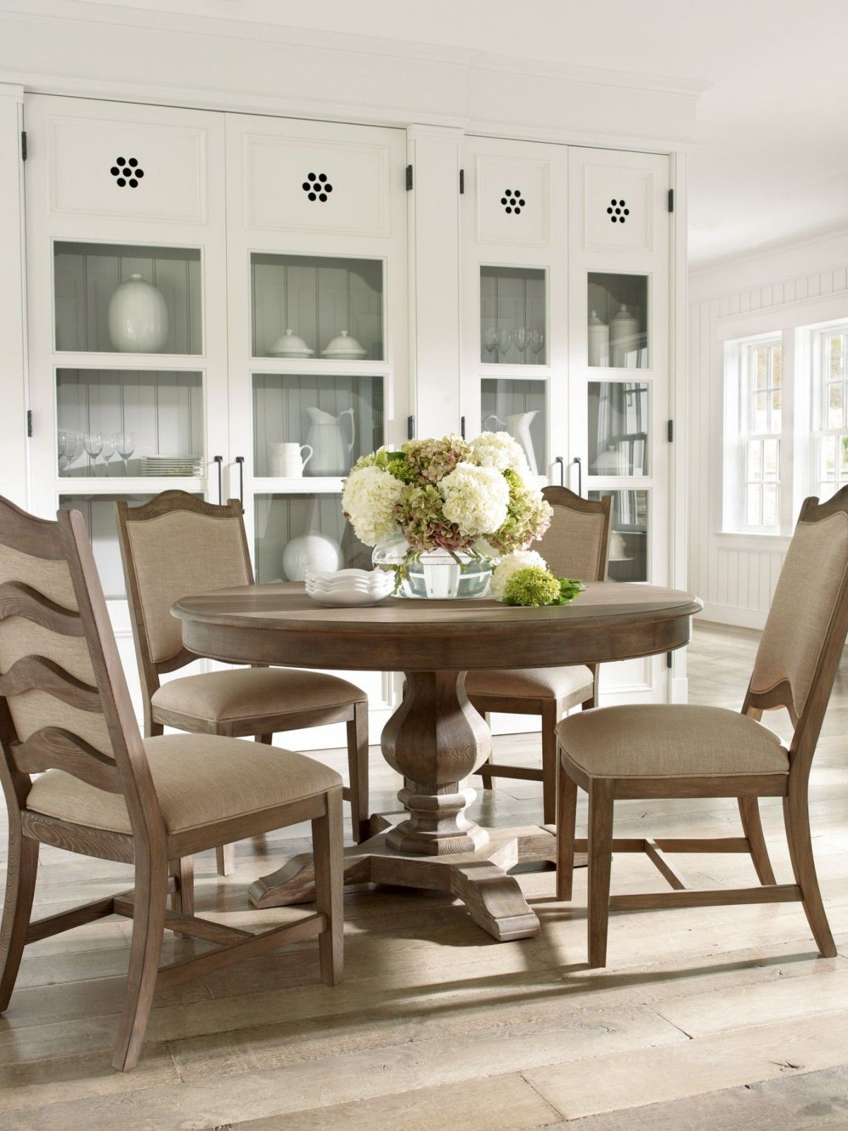 Ash Solids And Veneers Make Up This Gorgeous Round Dining