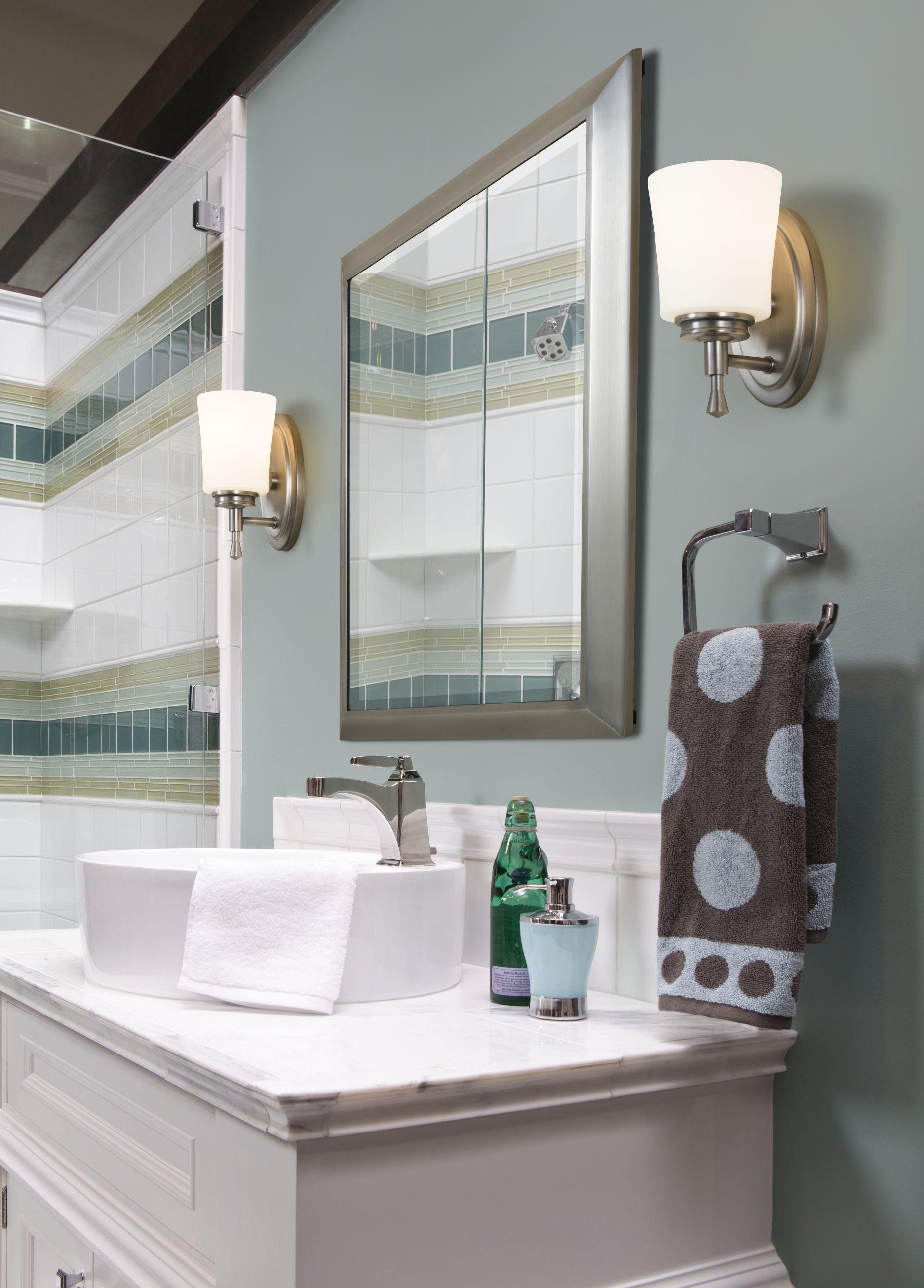 Kichler wharton sconces flank a bathroom vanity bathroomlightingideas bathroomlighting bathlighting kichler lightsonline