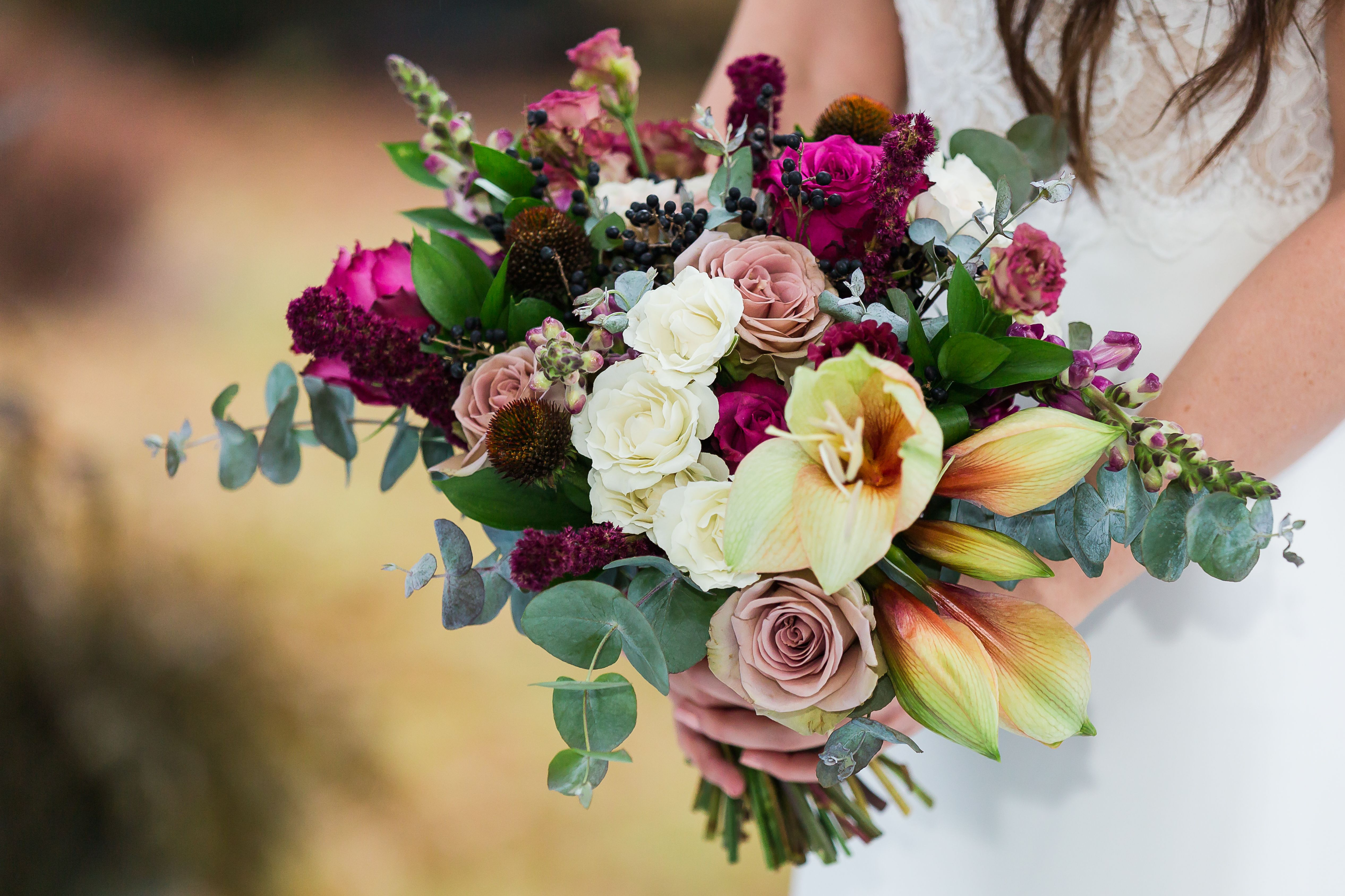 Bridal bouquet with amaryllis and garden roses. Burgundy