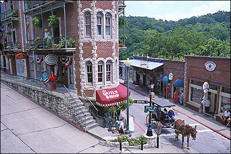"The National Trust for Historic Preservation named Eureka Springs, AR as one of its ""Dozen Distinctive Destinations."" Streets are lined with Victorian homes hugging cliffsides, and its entire downtown area is on the National Register of Historic Places."