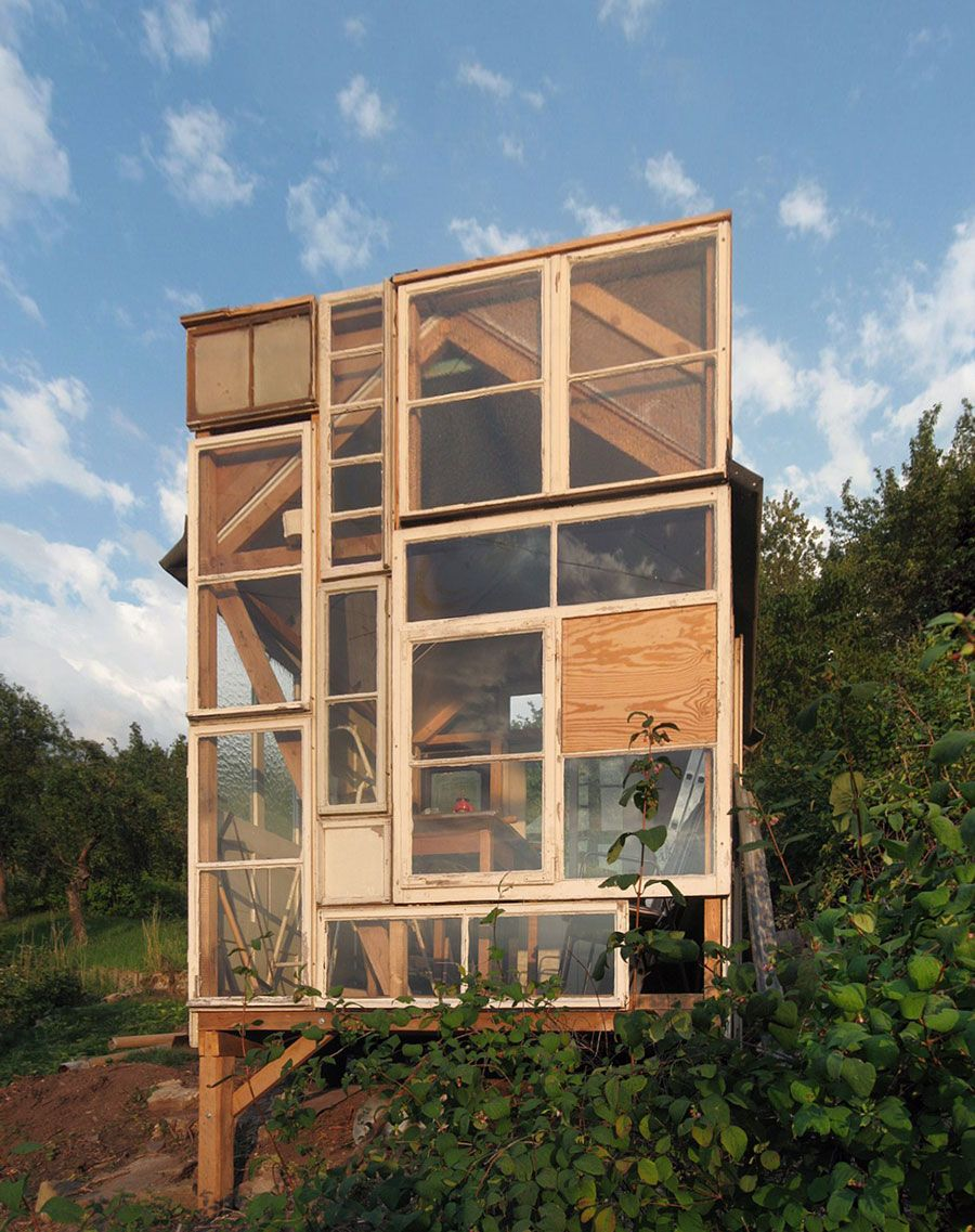 A tiny garden house built from old window panes in for Small house design germany