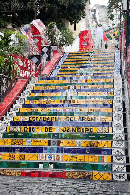 MOSAIC STAIRCASE, RIO: Many of us talk about labors of love, but Jorge Selarón has been tirelessly decorating the St Teresa staircase in the Lapa neighborhood of Rio de Janeiro, Brazil for over 20 years. This massive living artwork, which is now known as Escadaria Selarón, or Selaron's stiarcase, is 125 meters high and includes colorful tiles from all over the world.