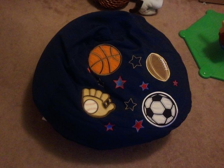 Brand New Circo Bean Bag, blue in color with sports patches. $15