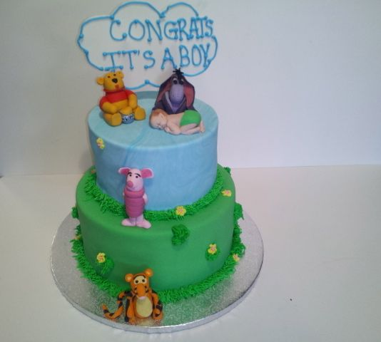 Pooh & Friends Baby Shower - Both tiers are covered in fondant. Characters are fondant & gum paste. Mold was used for the baby but not the characters.