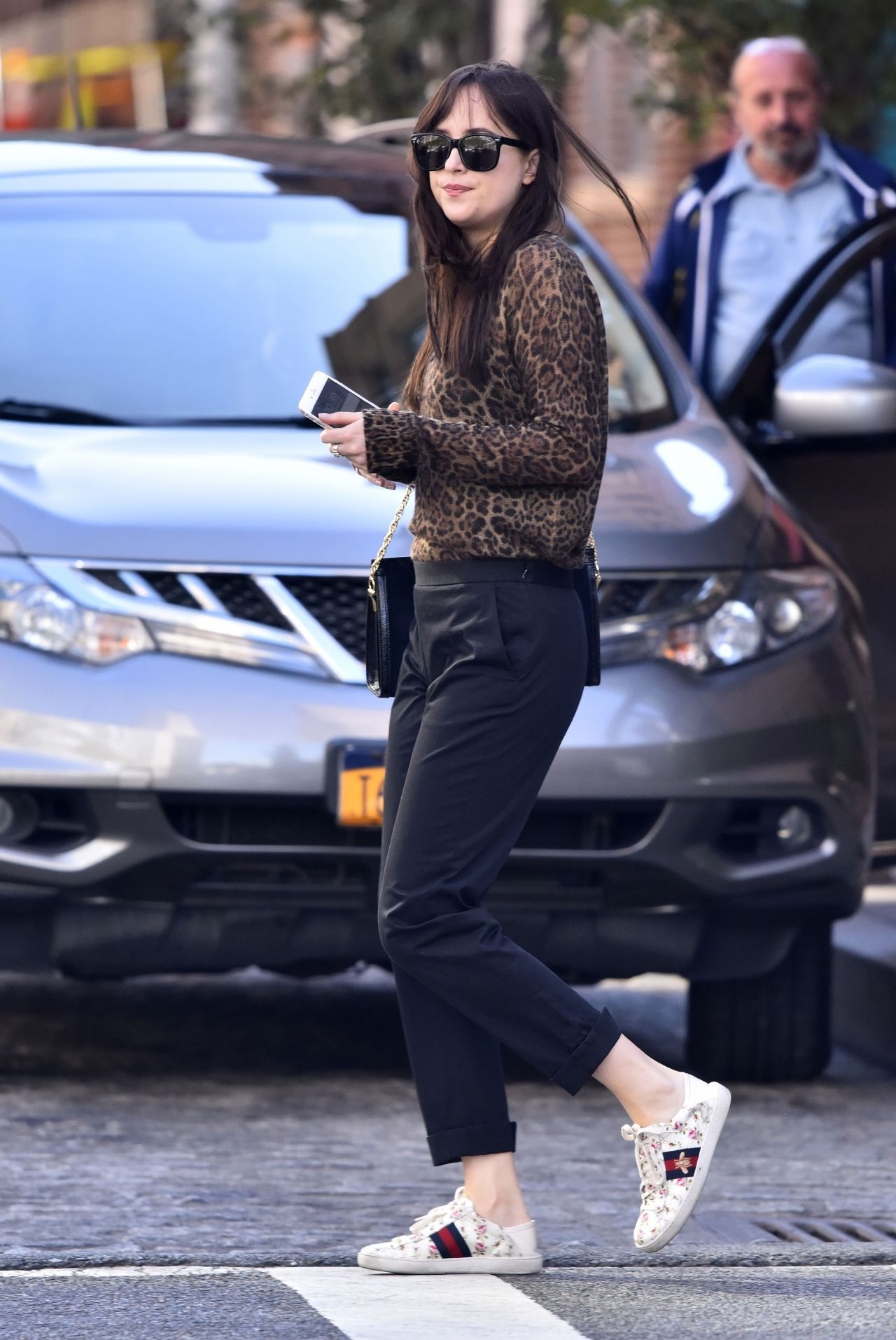Dakota johnson in leopard top and gucci white sneakers and bag new york