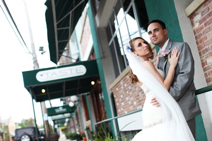 This couple has good #taste-- look at the sign behind them! #weddings #backgrounds #toocute