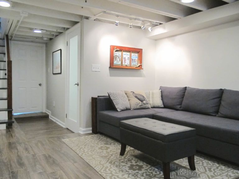 Cozy Chic Basement Reno With Exposed Painted Joists Wood Tile Floors Exposed Basement Ceiling Small Basement Design Home Remodeling