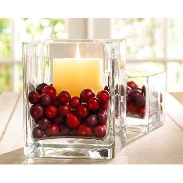 Cranberry and candles in clear glass
