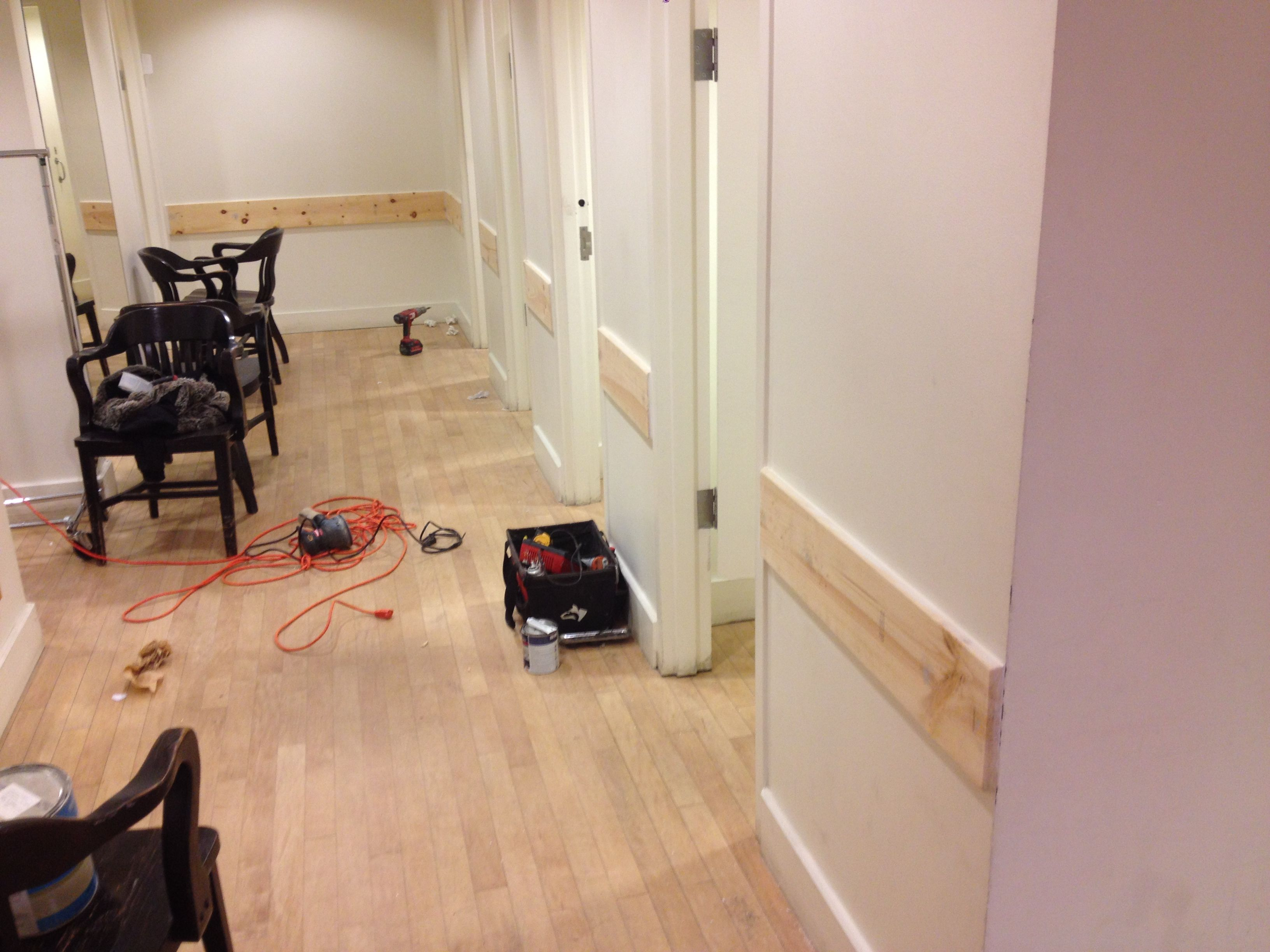 Installing wall guards..