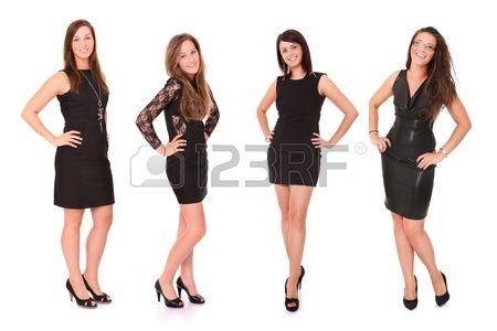 Cuatro mujeres vestidas de negro, posando para la foto. Foto de archivo.
