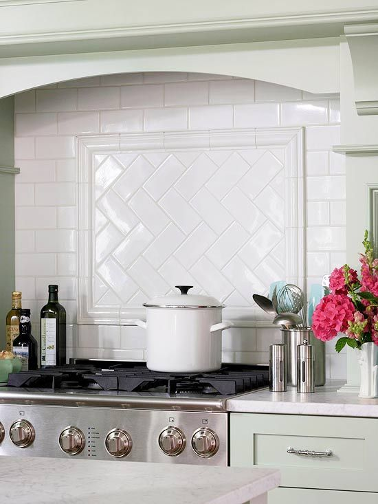 white subway tile backsplash with an accent panel in a herringbone pattern mint green