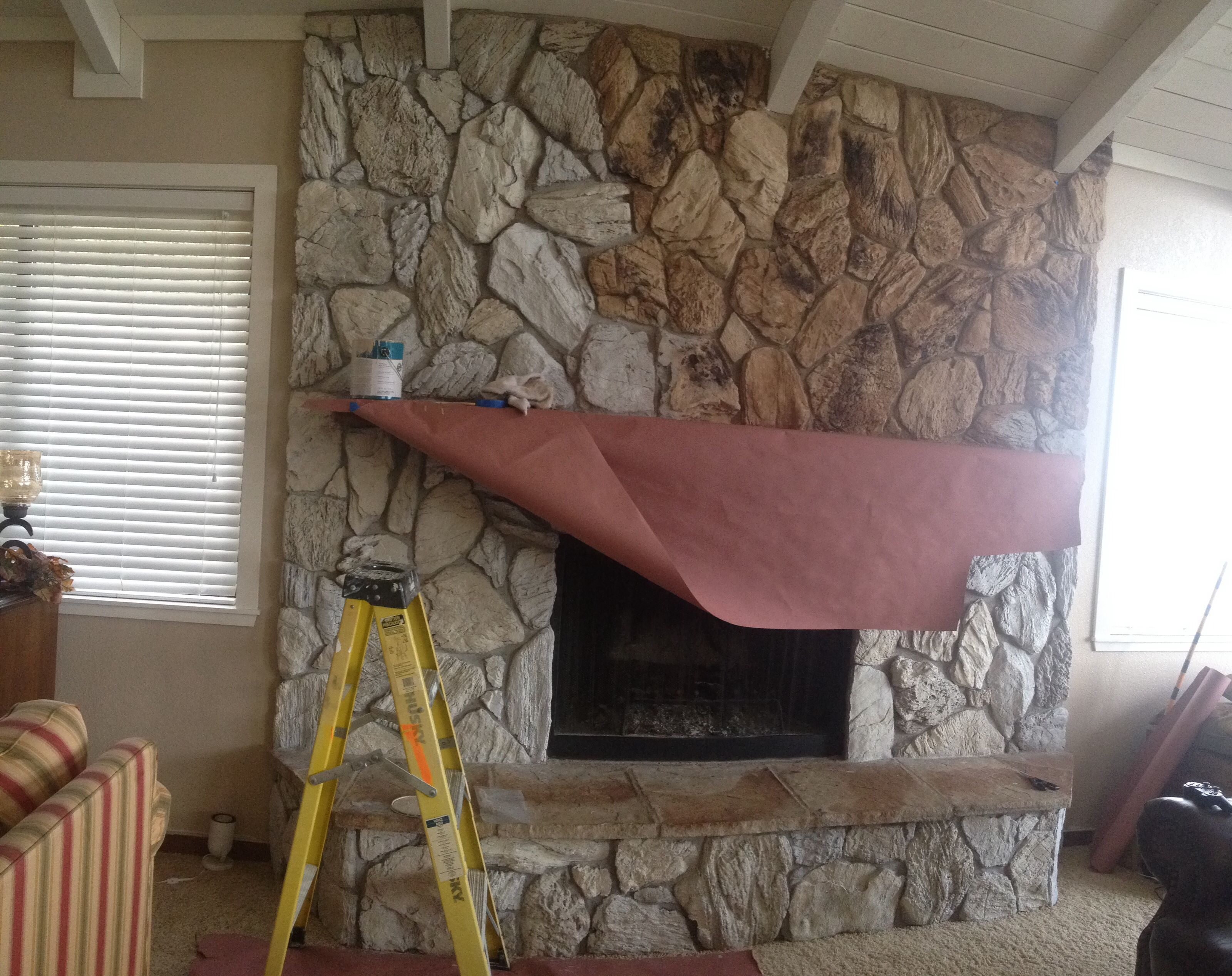 change your old 70 s fireplace with paint keep the rock look
