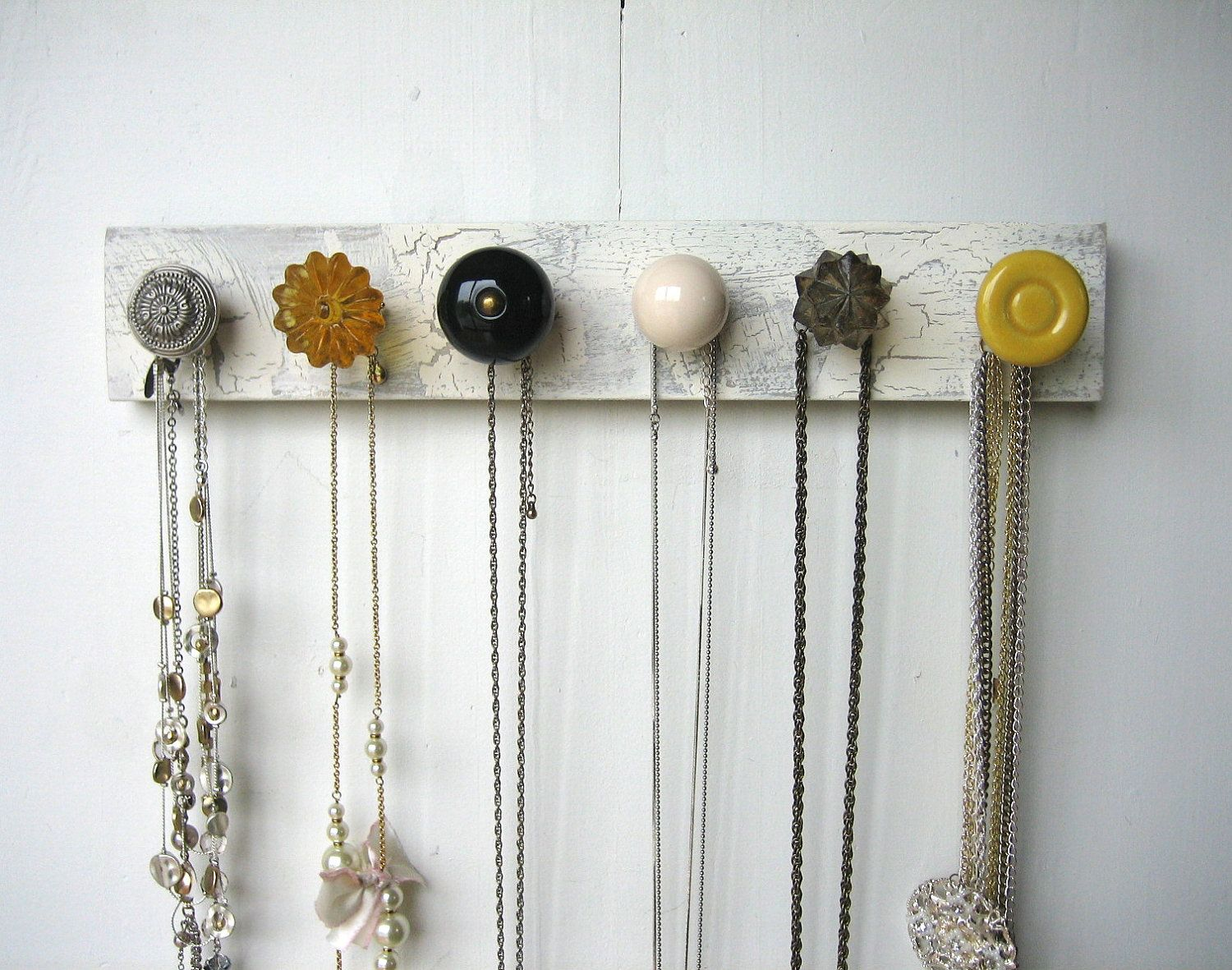 Hanging Jewelry Organizer with Yellow and Gray Knobs Necklace