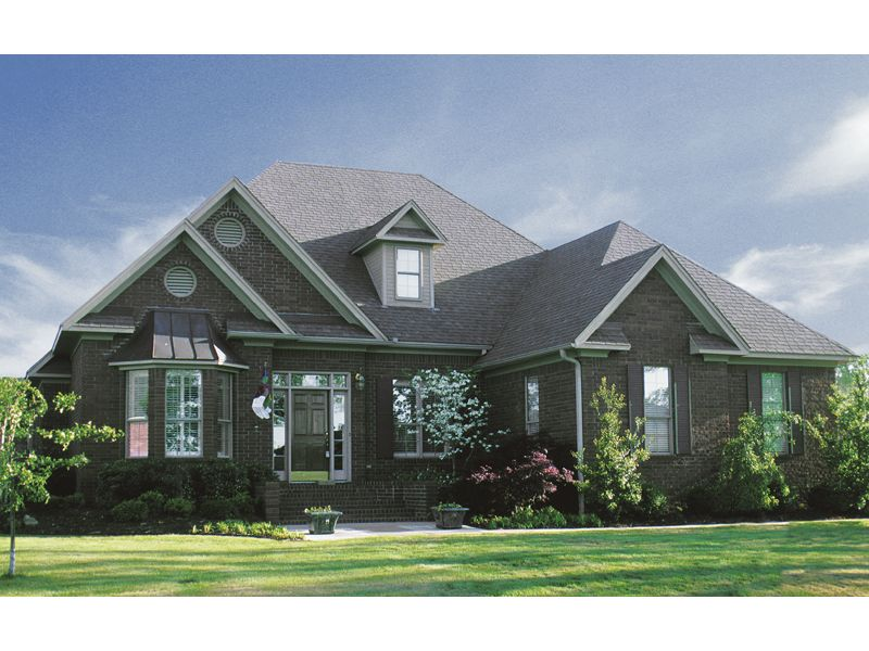 Portland Cove  Country Home  Luxurious Two-Story Home With Bay Window And Multiple Gables from houseplansandmore.com