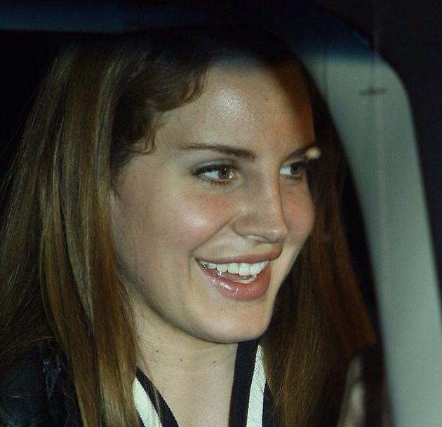 Lana Del Rey in the car, smiling