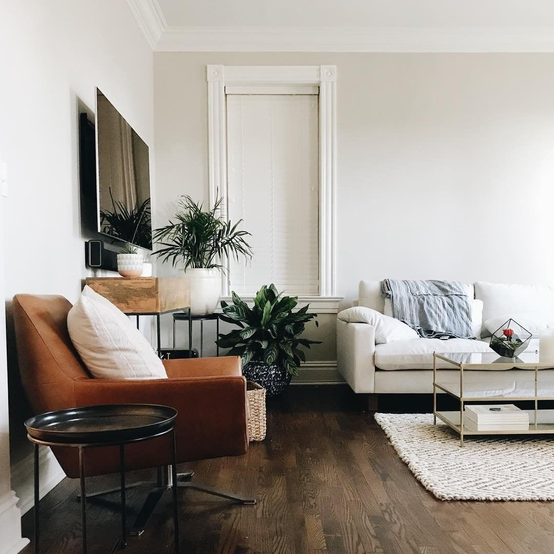 Brown leather, industrial wood, crown molding and plants! When can ...