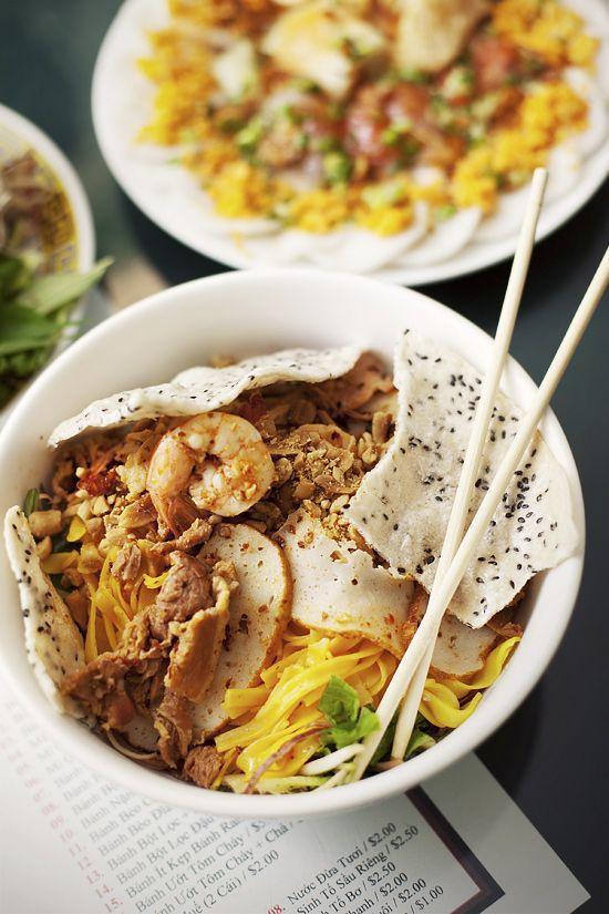 Mi Quang (dry egg noodles with pork, shrimp, and fishcake) Vietnamese food by a la mode