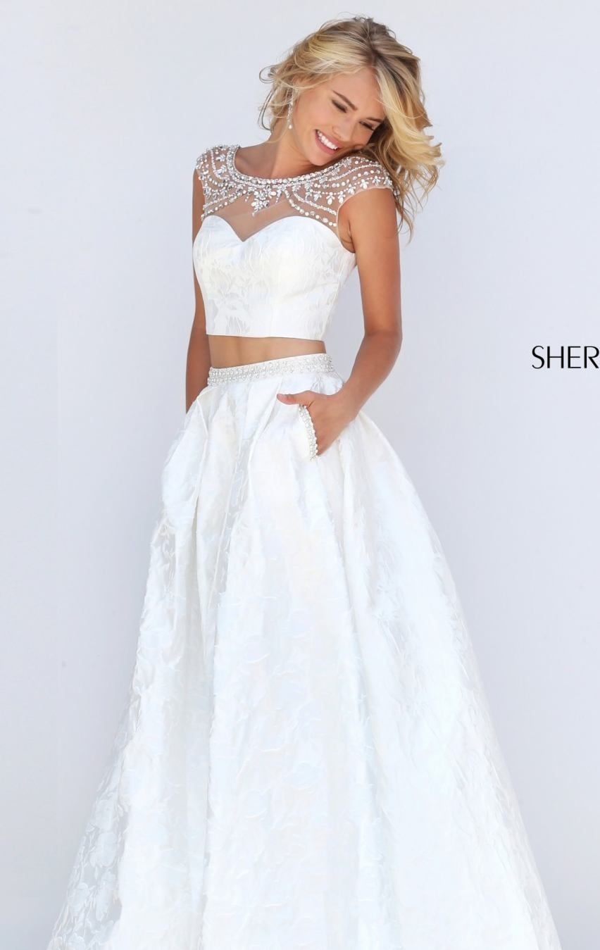 Radiate beauty and sophistication in this twopiece set gown sherri