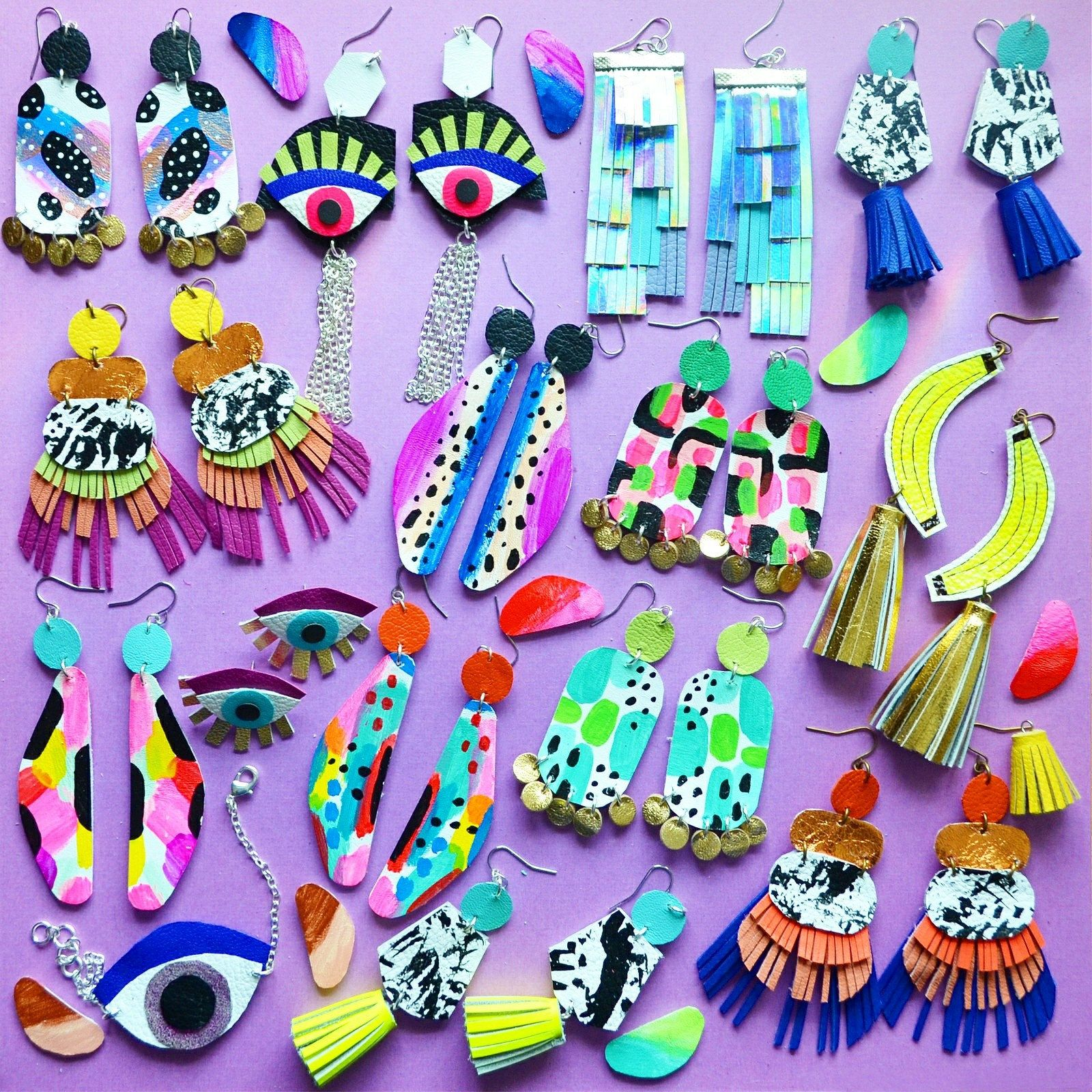 So many colorful pieces available including my new hand painted drop earrings and classics like my eye earrings! 👁👁👄👅💜💛💚💙