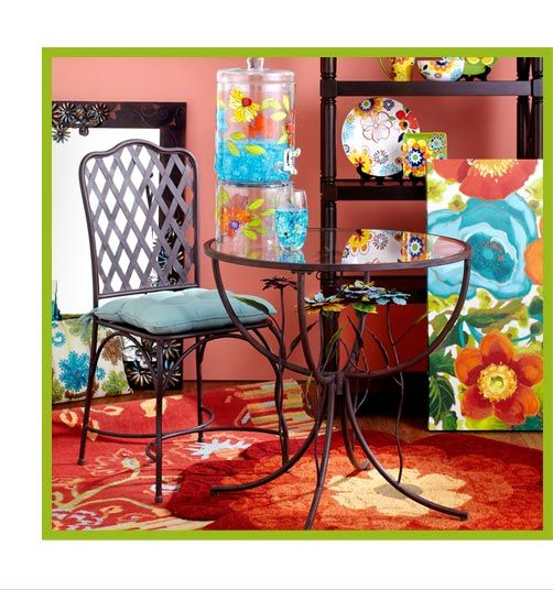 Colorful Patio Ideas from Pier 1 - love the flowers under the table ...