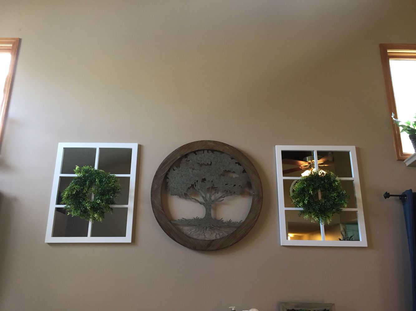 Large wall decor. Tree. Mirror with wreath. Living Room.