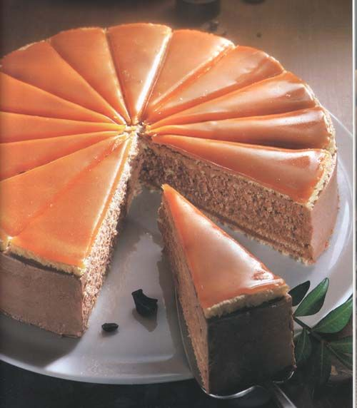 Dobos cake. Light chocolate cream between thin layers of sponge cake with hard caramel on top. A delicious cake created by well known 19th century Hungarian pastry chef József Dobos.
