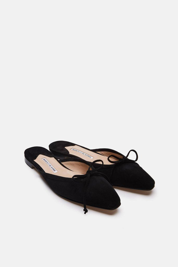 4289c9995c5e4 Among Manolo Blahnik s most elegant creations is this hybrid of a ballerina  flat and a mule. Crafted in Italy of velvety black suede